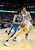 Minnesota Timberwolves guard Ricky Rubio, left, of Spain, drives past Denver Nuggets center JaVale McGee in the first quarter of an NBA basketball game on Saturday, March 9, 2013, in Denver.  (AP Photo/Chris Schneider)