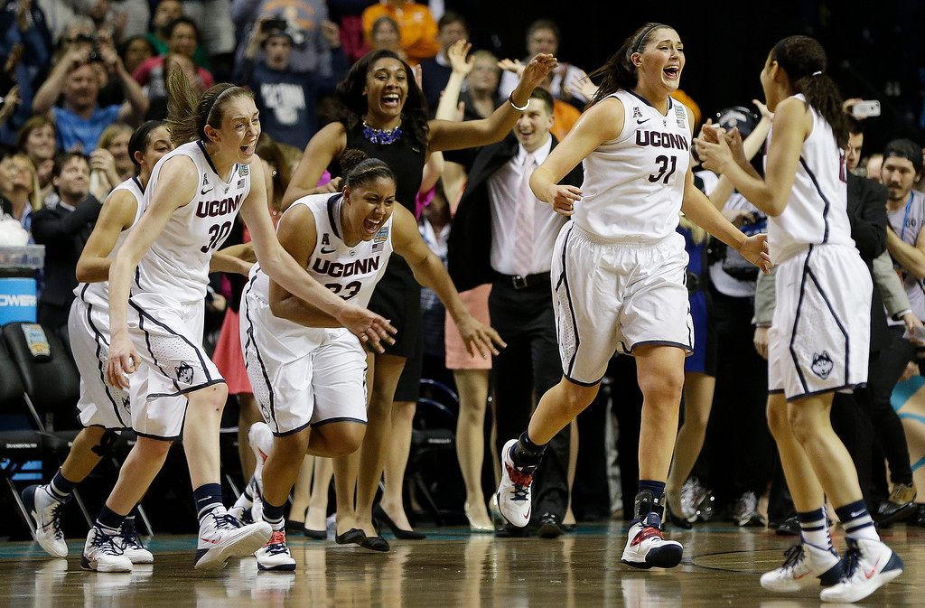 Description of . Connecticut players leave the bench after the second half of the championship game against Notre Dame in the Final Four of the NCAA women's college basketball tournament, Tuesday, April 8, 2014, in Nashville, Tenn. Connecticut won 79 -58. (AP Photo/Mark Humphrey)