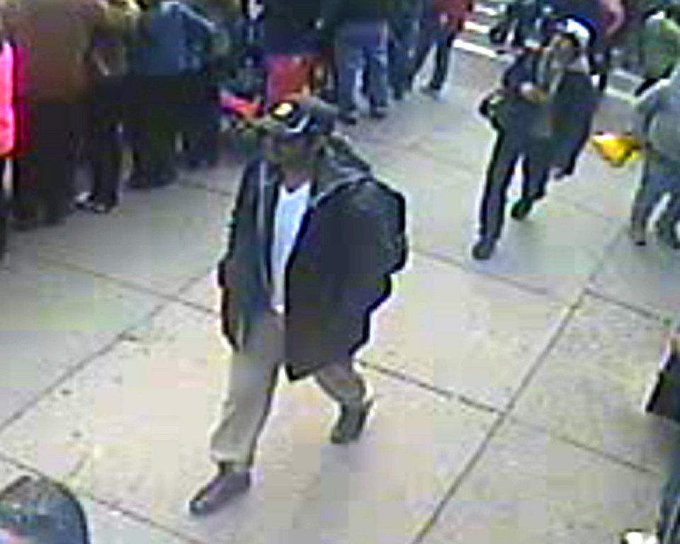 Description of . This image released by the FBI on Thursday, April 18, 2013, shows in a image from video what the FBI are calling suspect number 1, front, in black cap, and suspect number 2, in white cap, back right, walking near each other through the crowd in Boston on Monday, April 15, 2013, before the explosions at the Boston Marathon. (AP Photo/FBI)