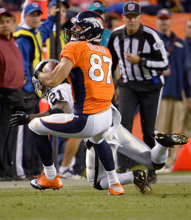 Description of . Denver Broncos wide receiver Eric Decker (87) looks up field after catching a pass during the second quarter. The Denver Broncos took on the Oakland Raiders at Sports Authority Field at Mile High in Denver on September 23, 2013. (Photo by Joe Amon/The Denver Post)