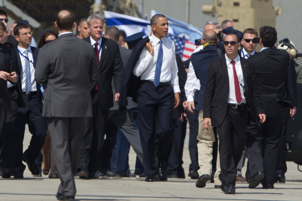 Description of . US President Barack Obama (C) walks away after visiting an Iron Dome missile battery (not seen) at the Ben Gurion Airport on March, 20, 2013 near Tel Aviv, Israel. (Photo by Uriel Sinai/Getty Images)