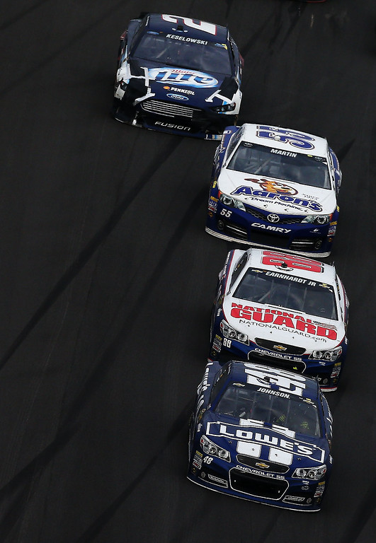Description of . Jimmie Johnson, driver of the #48 Lowe's Chevrolet, leads the field during the NASCAR Sprint Cup Series Daytona 500 at Daytona International Speedway on February 24, 2013 in Daytona Beach, Florida.  (Photo by Jonathan Ferrey/Getty Images)