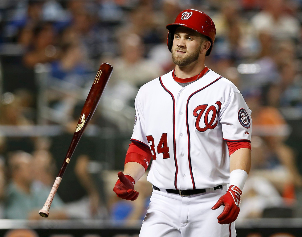 Description of . National League's Bryce Harper, of the Washington Nationals, flips his bat after lining out to end the third inning against the American League during Major League Baseball's All-Star Game in New York, July 16, 2013. REUTERS/Mike Segar