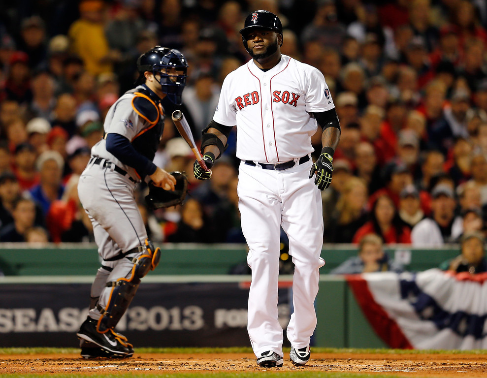 Description of . David Ortiz #34 of the Boston Red Sox reacts after striking out in the first inning against the Detroit Tigers during Game Two of the American League Championship Series at Fenway Park on October 13, 2013 in Boston, Massachusetts.  (Photo by Jim Rogash/Getty Images)