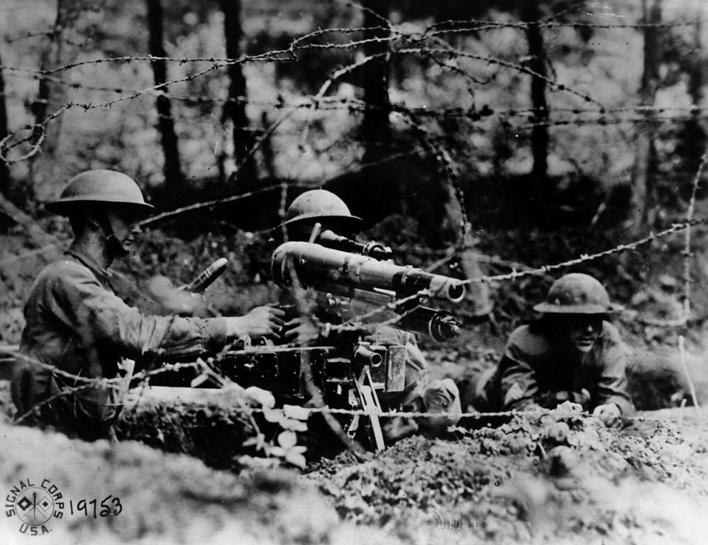 Description of . 26th June 1918:  American soldiers manning a French '37', a one-pounder in firing position behind barbed wire in a second line trench at Dieffmatten, in Alsace.  (Photo by Allen H. Hanson/Hulton Archive/Getty Images)