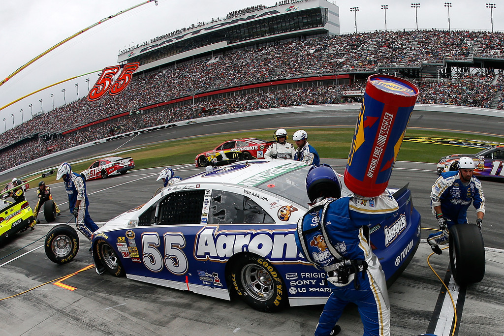 Description of . Mark Martin, driver of the #55 Aaron's Dream Machine Toyota, pits  during the NASCAR Sprint Cup Series Daytona 500 at Daytona International Speedway on February 24, 2013 in Daytona Beach, Florida.  (Photo by Chris Graythen/Getty Images)