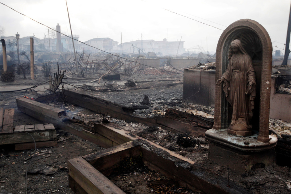 Description of . In this Oct. 30, 2012 file photo, damage caused by a fire in the Breezy Point section of the Queens borough of New York is shown. The fire department sent more than 190 firefighters to the blaze caused by superstorm Sandy.  (AP Photo/Frank Franklin II, File)