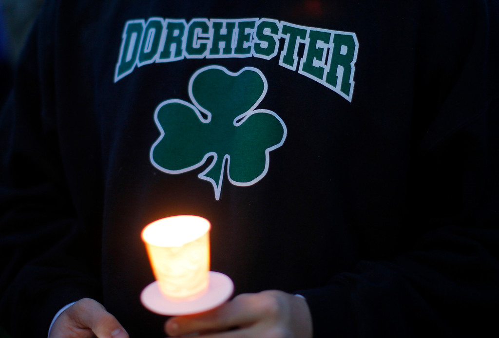 Description of . A man holds a candle during a candlelight vigil in the Dorchester neighborhood of Boston, Massachusetts April 16, 2013 where eight-year-old Boston Marathon explosion victim Martin Richard lived. A Little League baseball player, Martin lived in the blue Victorian house in working-class Dorchester - a Boston neighborhood dotted with