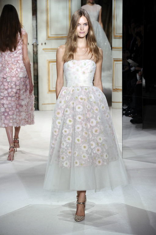Description of . A model wears a creation by fashion designer Giambattista Valli as part of his Spring/Summer 2013 Haute Couture fashion collection, in Paris, Monday, Jan. 21, 2013. (AP Photo/Zacharie Scheurer)
