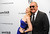 Actress Patricia Clarkson and designer Michael Kors attend amfAR's New York gala at Cipriani Wall Street on Wednesday, Feb. 6, 2013 in New York. (Photo by Evan Agostini/Invision/AP)
