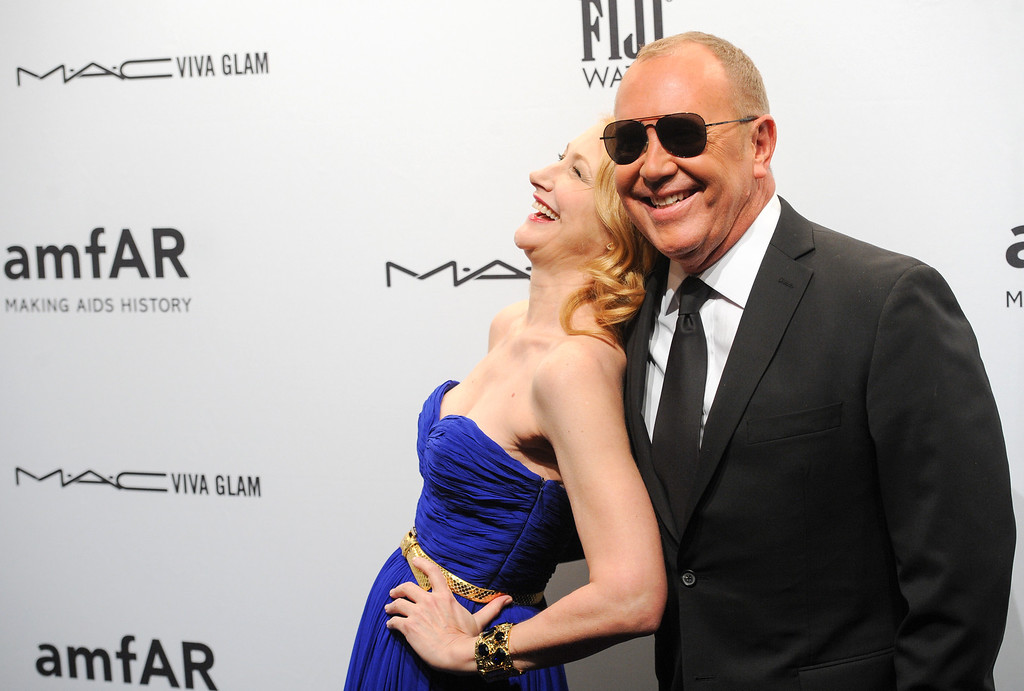 Description of . Actress Patricia Clarkson and designer Michael Kors attend amfAR's New York gala at Cipriani Wall Street on Wednesday, Feb. 6, 2013 in New York. (Photo by Evan Agostini/Invision/AP)