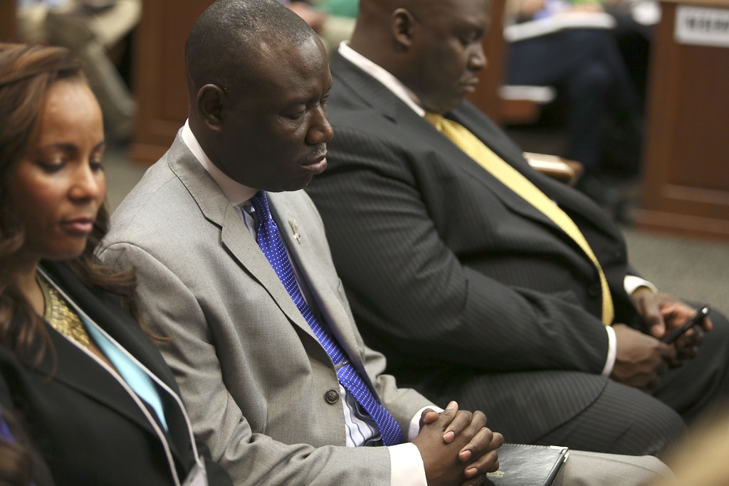 Description of . SANFORD, FL - JULY 13:  Attorneys (L-R) Natalie Jackson, Benjamin Crump and Daryl Parks sit in for the Martin family during George Zimmerman's trial in Seminole circuit court July 13, 2013 in Sanford, Florida. Zimmerman is charged with second-degree murder in the 2012 shooting death of Trayvon Martin.  (Photo by Gary W. Green-Pool/Getty Images)