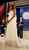 Michelle Obama listens to her husband, Preisdent Barack Obama, speak at the Obama Homes States Ball, one of ten official inaugural balls January 20, 2009 in Washington DC.  Obama was sworn in as the 44th President of the United States today, becoming the first African-American to be elected to the presidency.  (Photo by Mark Wilson/Getty Images)