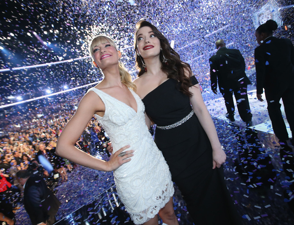 Description of . LOS ANGELES, CA - JANUARY 08:  Co-hosts Beth Behrs (L) and Kat Dennings attend The 40th Annual People's Choice Awards at Nokia Theatre L.A. Live on January 8, 2014 in Los Angeles, California.  (Photo by Christopher Polk/Getty Images for The People's Choice Awards)