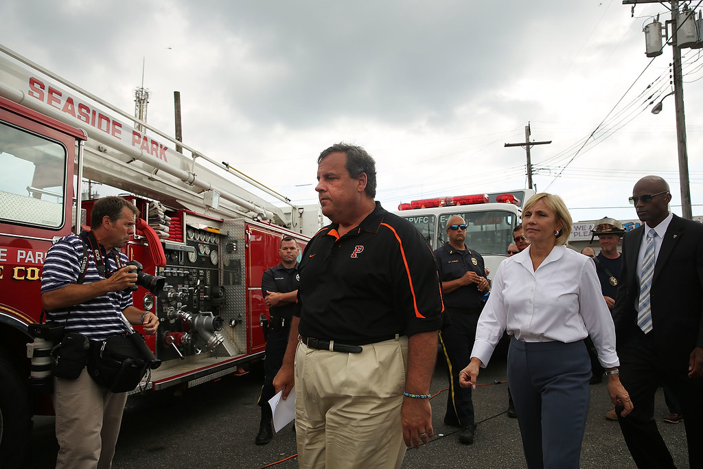 Description of . New Jersey Gov. Chris Christie walks away after speaking to the media at the scene of a massive fire that destroyed dozens of businesses along an iconic Jersey shore boardwalk on September 13, 2013 in Seaside Heights, New Jersey.  (Photo by Spencer Platt/Getty Images)