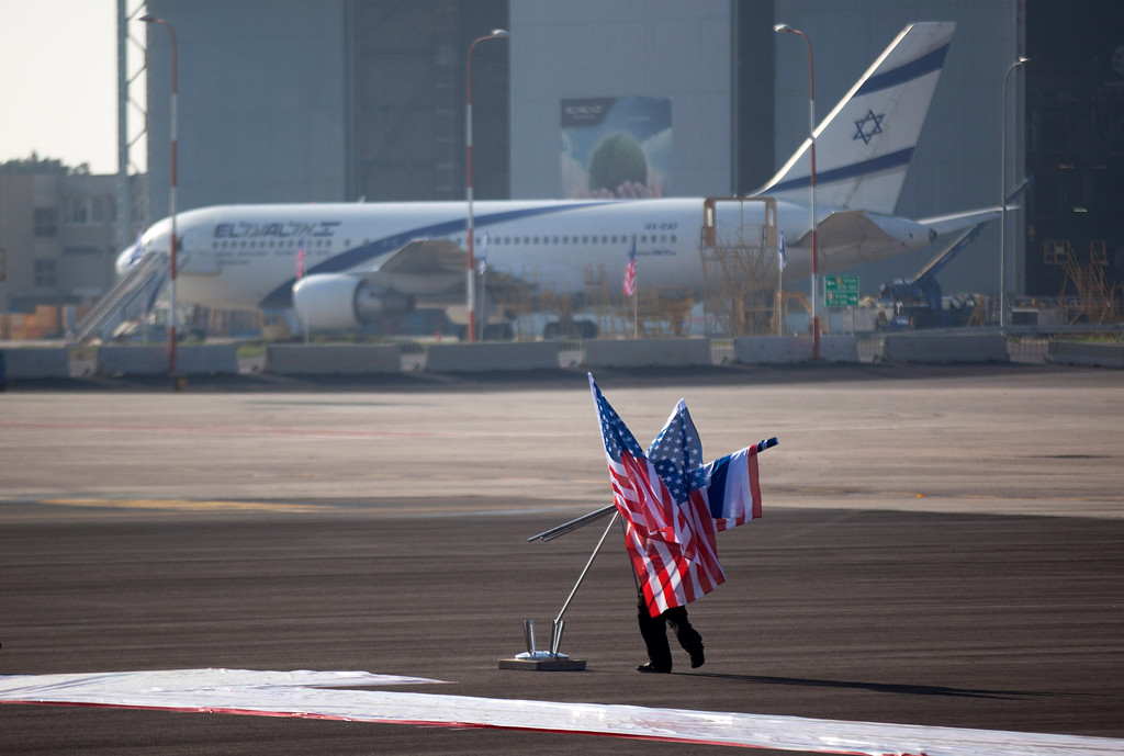 Description of . Workers make final preparations before an official welcoming ceremony for US President  Barack Obama on his arrival at Ben Gurion Airport, on March, 20, 2013 near Tel Aviv, Israel. (Photo by Uriel Sinai/Getty Images)