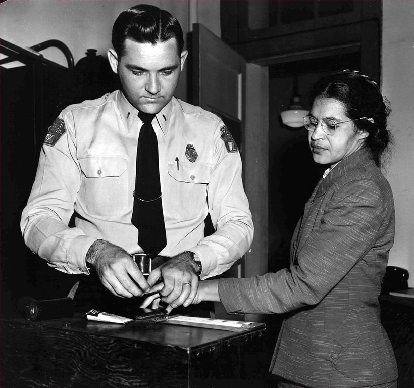 Description of . Rosa Parks, whose refusal to move to the back of a bus touched off the Montgomery bus boycott and the beginning of the civil rights movement, is fingerprinted by police Lt. D.H. Lackey in Montgomery, Ala., Feb. 22, 1956.  She was among some 100 people charged with violating segregation laws. (AP Photo/Gene Herrick)