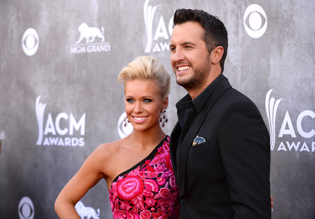 Description of . Luke Bryan, right, and Caroline Boyer arrive at the 49th annual Academy of Country Music Awards at the MGM Grand Garden Arena on Sunday, April 6, 2014, in Las Vegas. (Photo by Al Powers/Powers Imagery/Invision/AP)