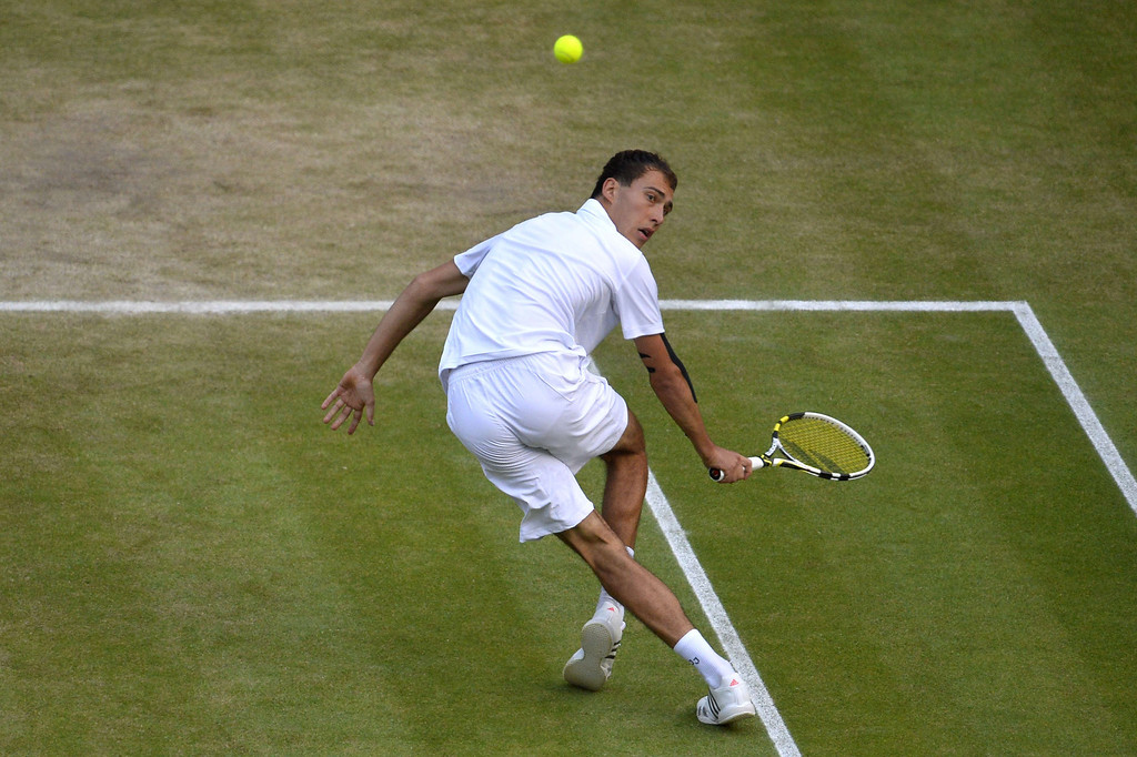 Description of . Poland\'s Jerzy Janowicz returns during his men\'s singles semi-final match against Britain\'s Andy Murray on day eleven of the 2013 Wimbledon Championships tennis tournament at the All England Club in Wimbledon, southwest London, on July 5, 2013. TOBY MELVILLE/AFP/Getty Images