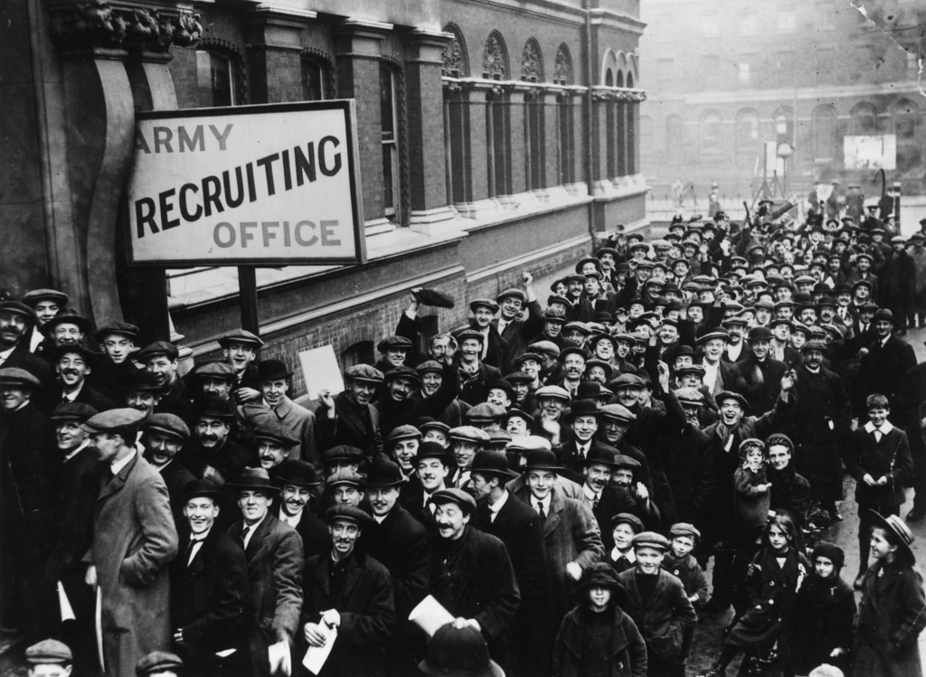 Description of . December 1915:  A crowd of young men queuing up at the Army Recruiting Office at Southwark Hall, south London, during Lord Derby's recruitment campaign.  (Photo by Topical Press Agency/Getty Images)