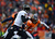 Baltimore Ravens quarterback Joe Flacco (5) scrambles from the pocket in the second quarter. The Denver Broncos vs Baltimore Ravens AFC Divisional playoff game at Sports Authority Field Saturday January 12, 2013. (Photo by AAron  Ontiveroz,/The Denver Post)
