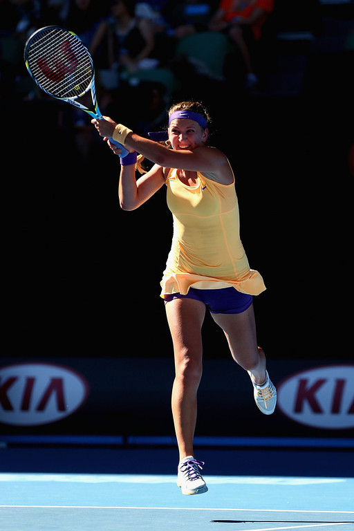 Description of . Victoria Azarenka of Belarus plays a backhand in her Semifinal match against Sloane Stephens of the United States during day eleven of the 2013 Australian Open at Melbourne Park on January 24, 2013 in Melbourne, Australia.  (Photo by Ryan Pierse/Getty Images)