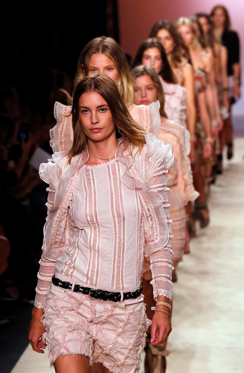 Description of . Models wear creations for Isabel Marant's ready-to-wear Spring/Summer 2014 fashion collection, presented in Paris, Friday, Sept.27, 2013. (AP Photo/Jacques Brinon)