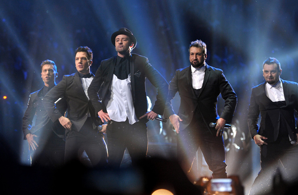Description of . Lance Bass, JC Chasez, Justin Timberlake, Joey Fatone and Chris Kirkpatrick, of 'N Sync, at the MTV Video Music Awards at Barclays Center on Sunday, Aug. 25, 2013, in the Brooklyn borough of New York. (AP Photo/ MTV, John Shearer)