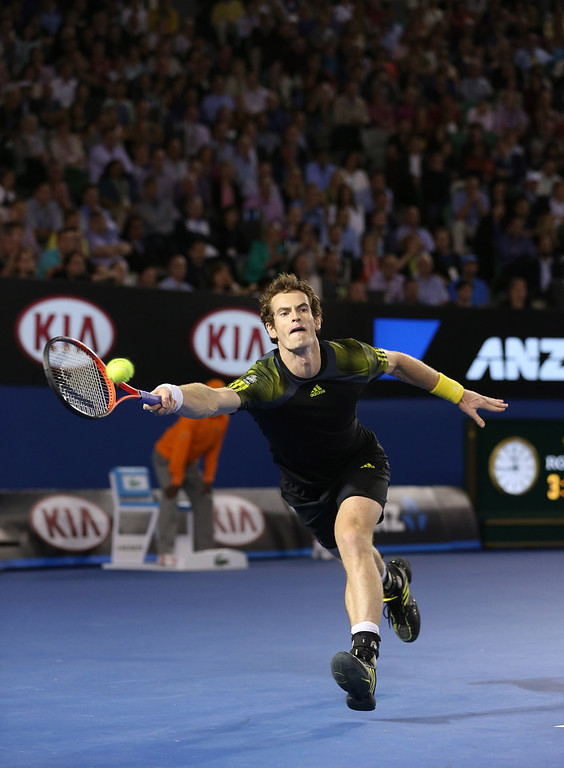 Description of . Britain's Andy Murray reaches for a return to Switzerland's Roger Federer during their semifinal match at the Australian Open tennis championship in Melbourne, Australia, Friday, Jan. 25, 2013. (AP Photo/Greg Baker)