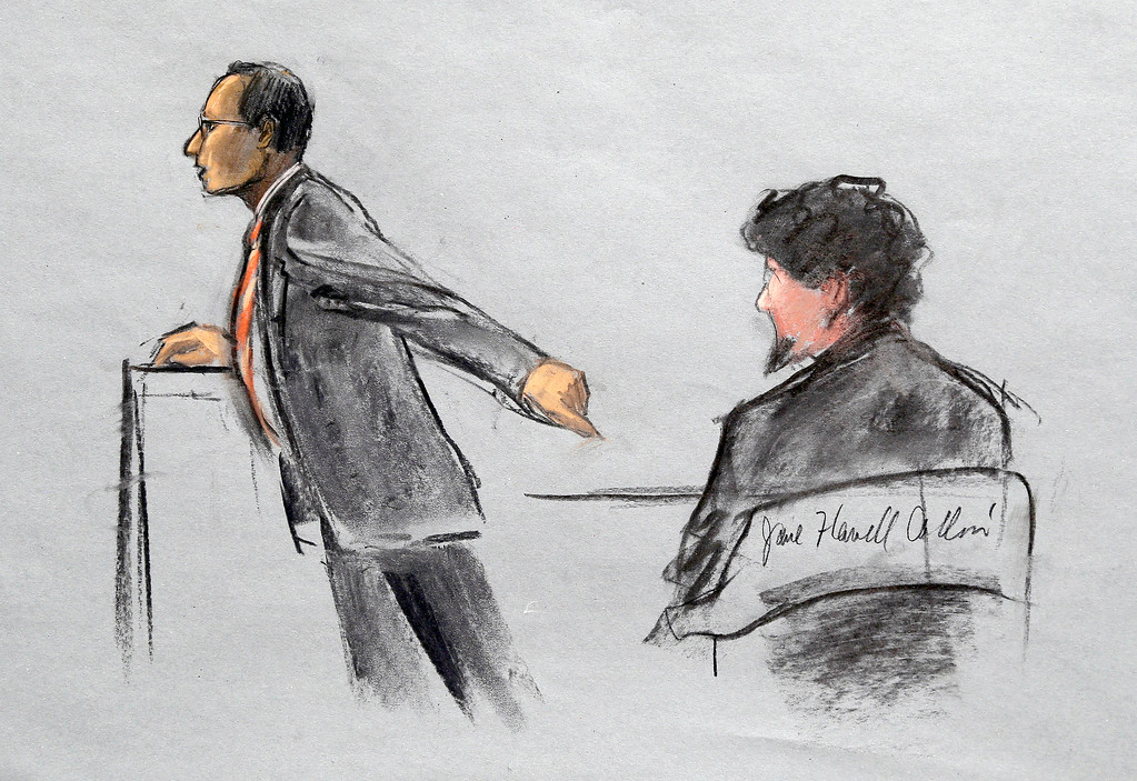 Description of . In this courtroom sketch, Assistant U.S. Attorney Aloke Chakravarty is depicted pointing to defendant Dzhokhar Tsarnaev, right, during closing arguments in Tsarnaev's federal death penalty trial Monday, April 6, 2015, in Boston. Tsarnaev is charged with conspiring with his brother to place two bombs near the Boston Marathon finish line in April 2013, killing three and injuring 260 people. (AP Photo/Jane Flavell Collins)