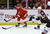 Detroit Red Wings right wing Daniel Cleary (11) passes the puck in front of Colorado Avalanche defenseman Matt Hunwick (22) during the second period of an NHL hockey game in Detroit, Tuesday, March 5, 2013. (AP Photo/Carlos Osorio)