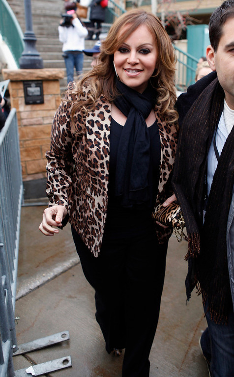 Description of . Singer Jenni Rivera stands on Main Street during the Sundance Film Festival in Park City, Utah in this January 20, 2012 file photo. Mexican-American singer Rivera is missing after the plane she was travel ling in disappeared shortly after leaving the northern Mexican city of Monterrey early on December 9, 2012. Rivera was heading for the city of Toluca in central Mexico after a concert in Monterrey on the night of December 8, 2012. The singer, two pilots and four other passengers are all missing, the ministry said. A search is continuing for the aircraft.    REUTERS/Jim Urquhart/Files