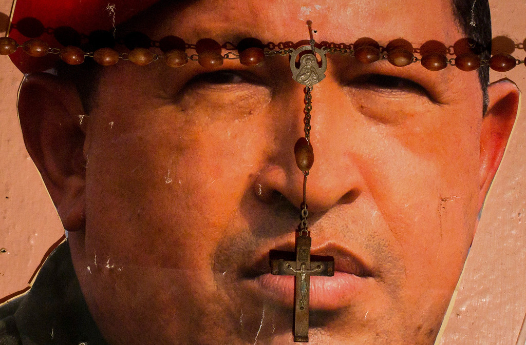 Description of . A picture of Venezuela's President Hugo Chavez is seen on a religious altar in Caracas January 4, 2013. Chavez is still suffering a