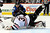 Chicago Blackhawks goalie Ray Emery (30) dives to make a save against Colorado Avalanche right wing P.A. Parenteau (15) during the first period of an NHL hockey game, Monday, March 18, 2013, in Denver. (AP Photo/Jack Dempsey)