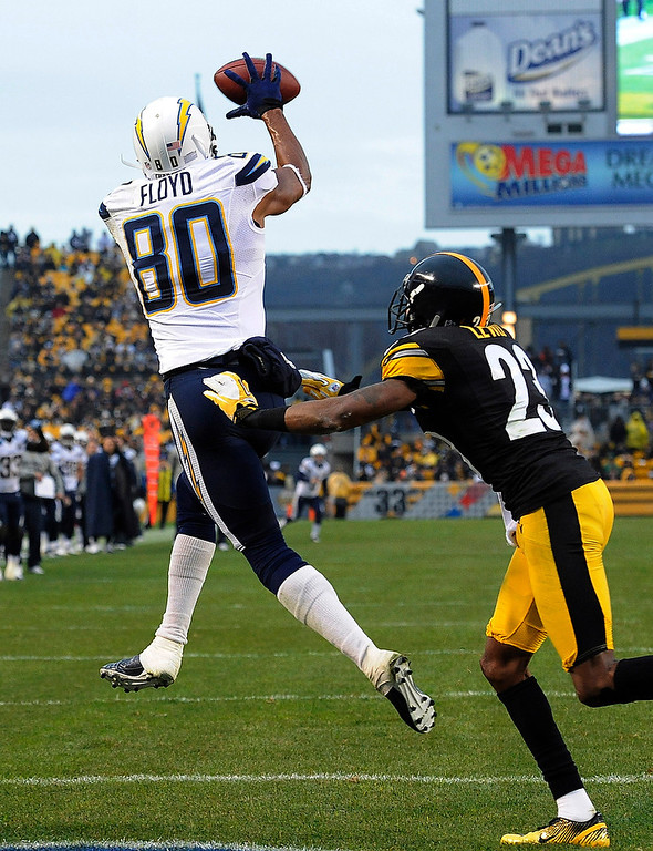 Description of . San Diego Chargers wide receiver Malcom Floyd (80) catches the ball for a touchdown in front of Pittsburgh Steelers cornerback Keenan Lewis (23) in the third quarter of an NFL football game on Sunday, Dec. 9, 2012, in Pittsburgh. (AP Photo/Don Wright)