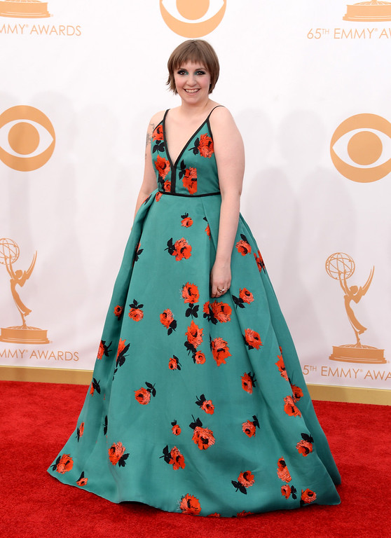 Description of . Actress Lena Dunham arrives at the 65th Annual Primetime Emmy Awards held at Nokia Theatre L.A. Live on September 22, 2013 in Los Angeles, California.  (Photo by Jason Merritt/Getty Images)
