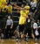 Oregon's Carlos Emory gets off a pass as Colorado's Askia Booker (0) and Andre Roberson, rear,  converge during the first half of Colorado's game against Oregon in an NCAA college basketball game at Matthew Knight Arena in Eugene, Ore. Thursday, Feb. 7, 2013. (AP Photo/Brian Davies)