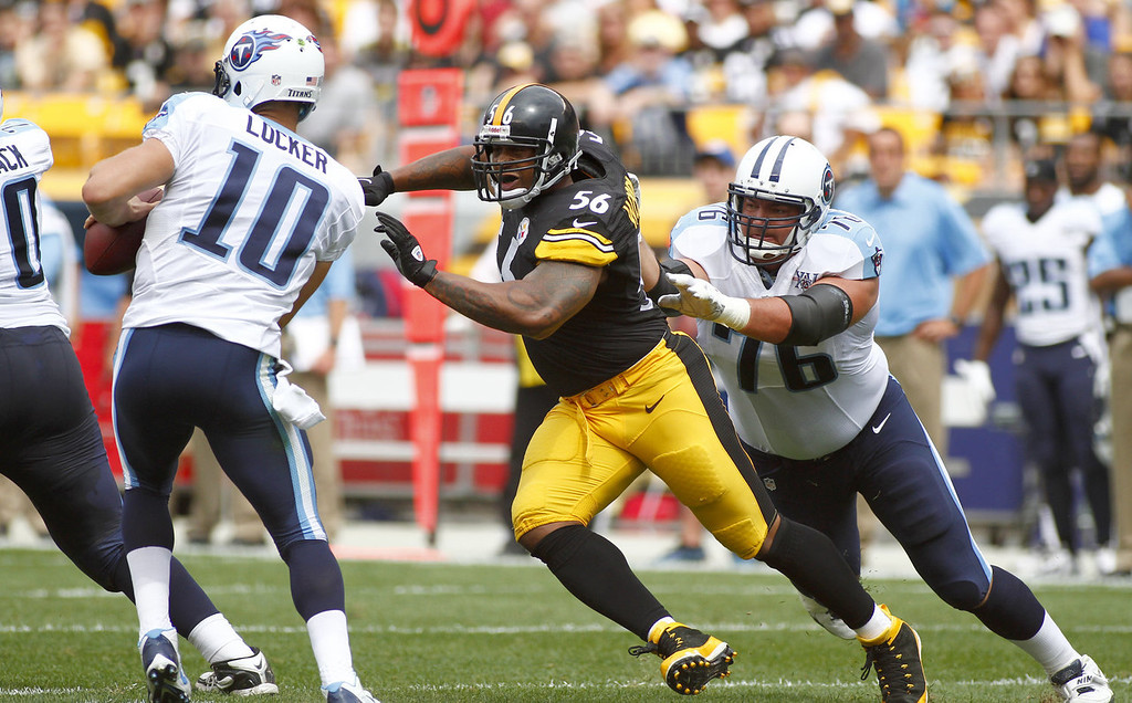 Description of . LaMarr Woodley #56 of the Pittsburgh Steelers sacks Jake Locker #10 of the Tennessee Titans in the first half during the game on September 8, 2013 at Heinz Field in Pittsburgh, Pennsylvania.  (Photo by Justin K. Aller/Getty Images)