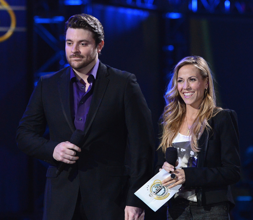 Description of . Sheryl Crow and Chris Young attend The GRAMMY Nominations Concert Live!! held at Bridgestone Arena on December 5, 2012 in Nashville, Tennessee.  (Photo by Kevin Winter/Getty Images)
