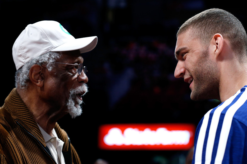 Description of . HOUSTON, TX - FEBRUARY 16:  NBA legend Bill Russell talks with Brook Lopez of the Brooklyn Nets before Lopez competes in the Sears Shooting Stars Competition part of 2013 NBA All-Star Weekend at the Toyota Center on February 16, 2013 in Houston, Texas. (Photo by Scott Halleran/Getty Images)