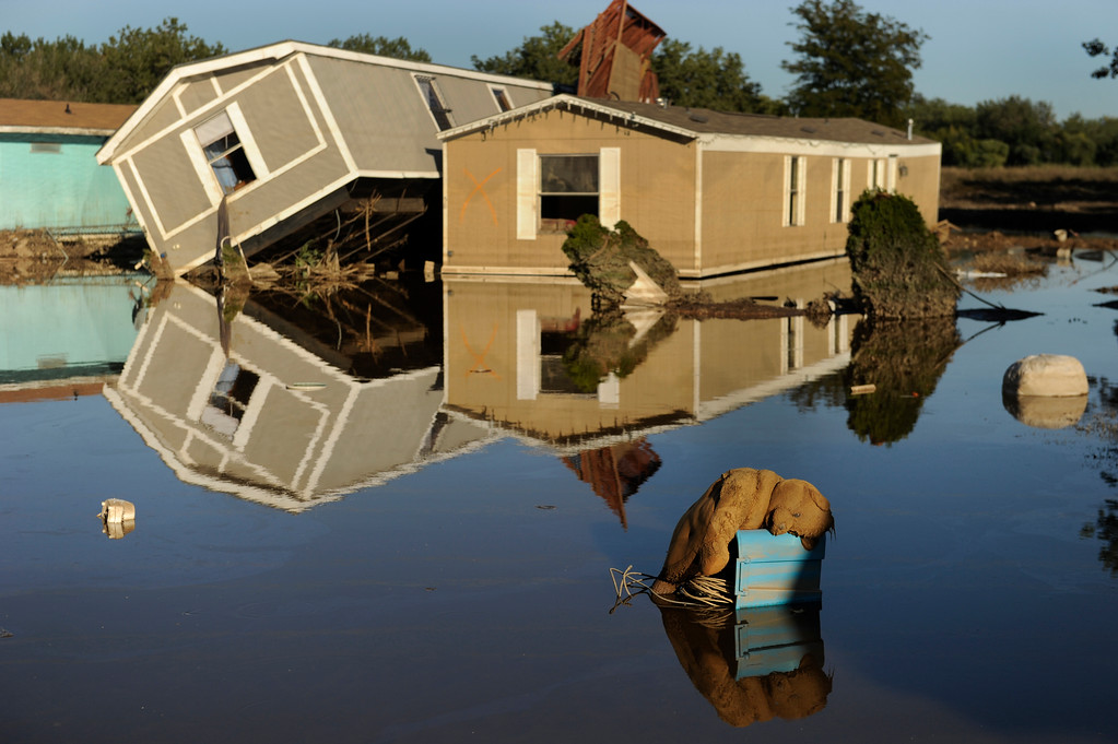Description of . EVANS, CO. - SEPTEMBER 21: A teddy bear clung to high ground inside the flooded Eastwood Village mobile home park in Evans. Residents of Evans continued the grim work of salvaging personal belongings from flooded homes Saturday afternoon, September 21, 2013. Photo By Karl Gehring/The Denver Post