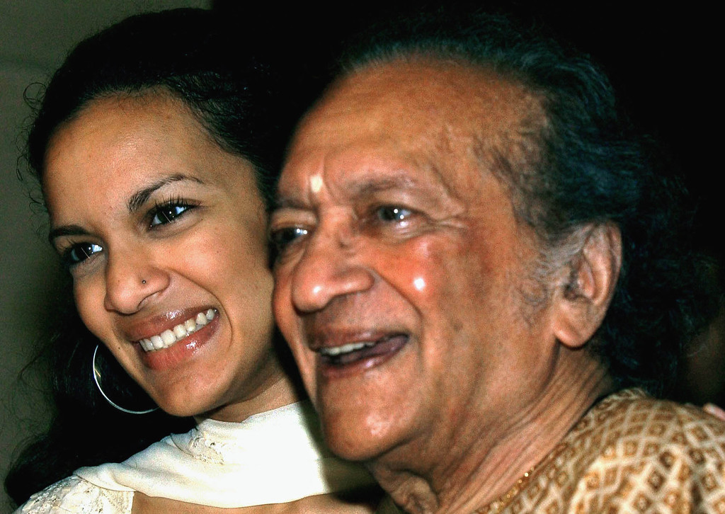 . Indian Sitar maestro Ravi Shankar, right, and daughter Anoushka Shankar smile during a press conference in Calcutta, India, in this Thursday, Dec. 19, 2002  photo. Shankar, the father of Norah Jones said that it was a joy seeing Norah get so many Grammy Awards Sunday, Feb. 23, 2003. (AP Photo/Bikas Das, File)