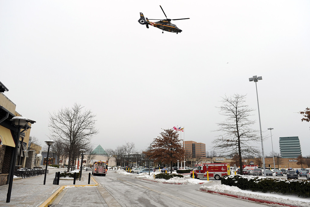 Description of . The Maryland State Police medivac flys over Columbia Town Center Mall after three people were killed in a shooting there January 25, 2014 in Columbia, Maryland. Police still do not have a motive for the shooting but believe the shooter has been killed. (Photo by Patrick Smith/Getty Images)