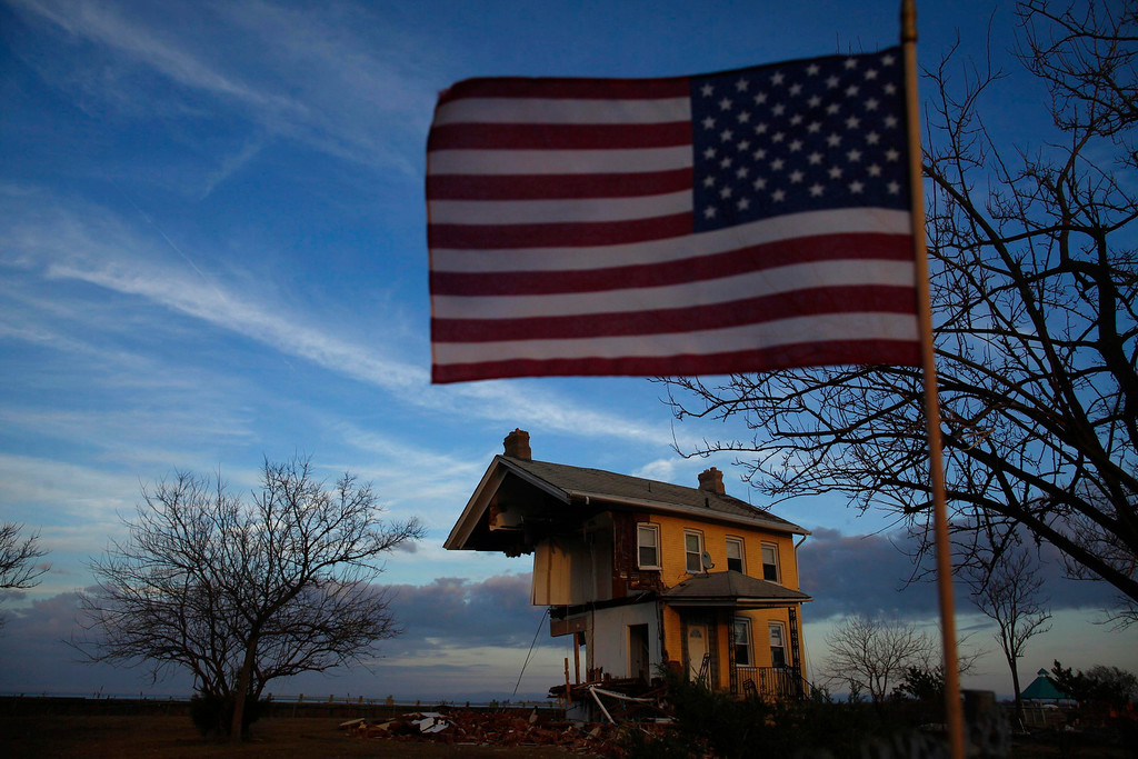 Description of . A home that was damaged by Hurricane Sandy, is seen in Union Beach, New Jersey November 12, 2012. At least 121 people perished in the storm, which caused an estimated $50 billion in property damage and economic losses and ranks as one of the most destructive natural disasters to hit the U.S. Northeast. REUTERS/Eric Thayer