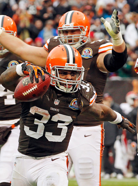Description of . Cleveland Browns running back Trent Richardson (33) celebrates after a 1-yard touchdown run against the Kansas City Chiefs in the third quarter of an NFL football game Sunday, Dec. 9, 2012, in Cleveland. (AP Photo/Tony Dejak)