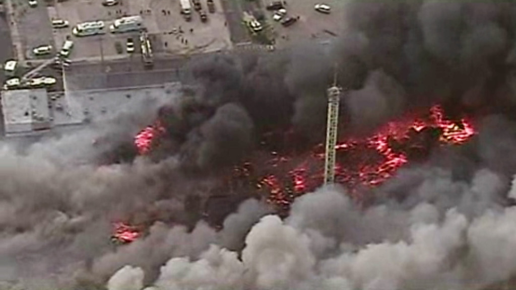 Description of . This image from aerial video shows a raging fire in Seaside Park, N.J. on Thursday, Sept. 12, 2013. The fire began in a frozen custard stand on the Seaside Park section of the boardwalk and quickly spread north into neighboring Seaside Heights. (AP Photo/ABC)