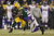 Running back DuJuan Harris #26 of the Green Bay Packers runs the ball as he is tackled by outside linebacker Erin Henderson #50 of the Minnesota Vikings in the third quarter during the NFC Wild Card Playoff game at Lambeau Field on January 5, 2013 in Green Bay, Wisconsin.  (Photo by Andy Lyons/Getty Images)