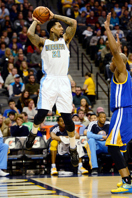 Description of . Denver Nuggets shooting guard Wilson Chandler (21) saves a loose ball against the Golden State Warriors during the first half at the Pepsi Center on Sunday, January 13, 2013. AAron Ontiveroz, The Denver Post