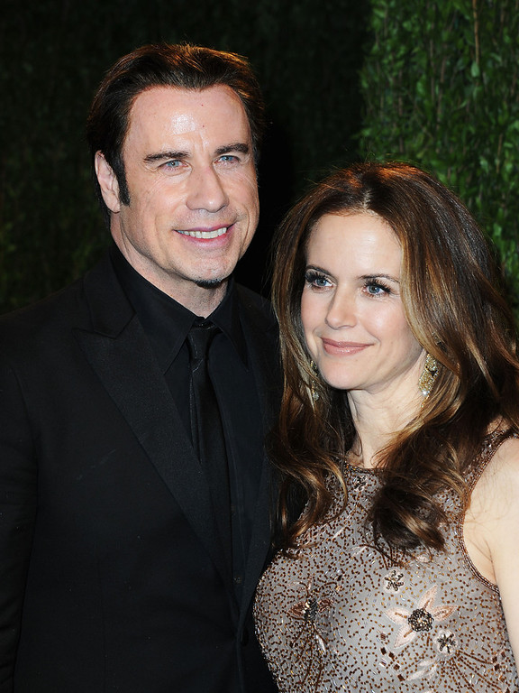 Description of . Actors John Travolta (L) and Kelly Preston arrive at the 2013 Vanity Fair Oscar Party hosted by Graydon Carter at Sunset Tower on February 24, 2013 in West Hollywood, California.  (Photo by Pascal Le Segretain/Getty Images)