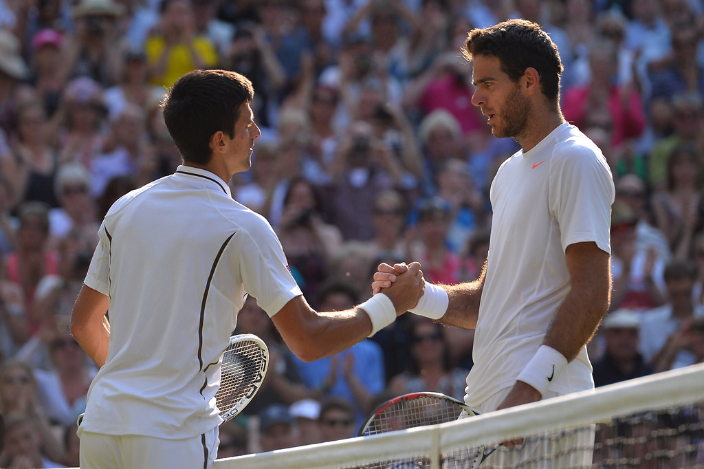 Description of . Serbia\'s Novak Djokovic (L) talks and shakes hands with Argentina\'s Juan Martin Del Potro (R) following Djokovic\'s victory in their men\'s singles semi-final match on day eleven of the 2013 Wimbledon Championships tennis tournament at the All England Club in Wimbledon, southwest London, on July 5, 2013. Djokovic won 7-5, 4-6, 7-6, 6-7, 6-3. CARL COURT/AFP/Getty Images